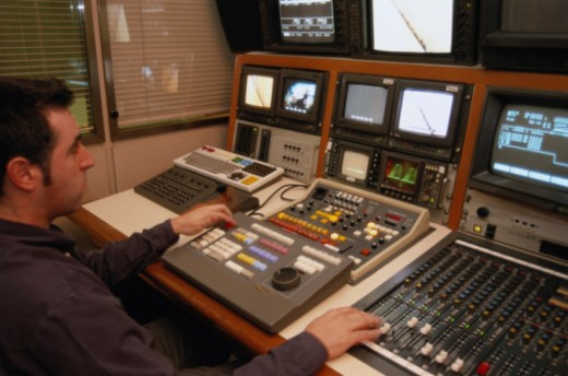 Stock Photo: 1598R-279723 Male videotape editor