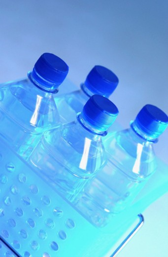 Four bottles of drinking water : Stock Photo