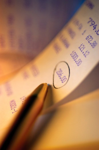 Close-up of encircled number on a roll of adding machine paper : Stock Photo