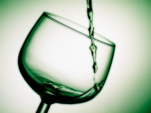 Stock Photo: 1598R-281809 White wine poured into a glass