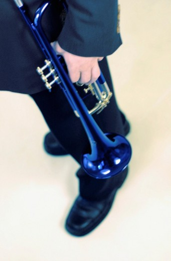 Man holding a trumpet, tilt : Stock Photo