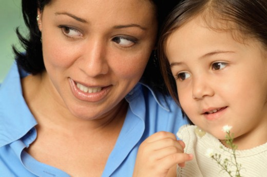 Portrait of smiling woman and girl, close-up : Stock Photo