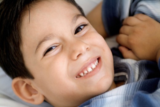 Portrait of smiling boy, close-up : Stock Photo