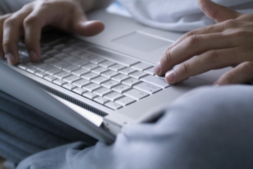 Stock Photo: 1598R-284296 Close-up of human hands on laptop