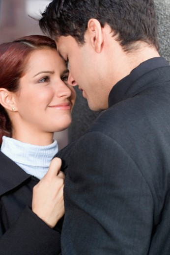Stock Photo: 1598R-285764 Young businessman and businesswoman hugging, close-up
