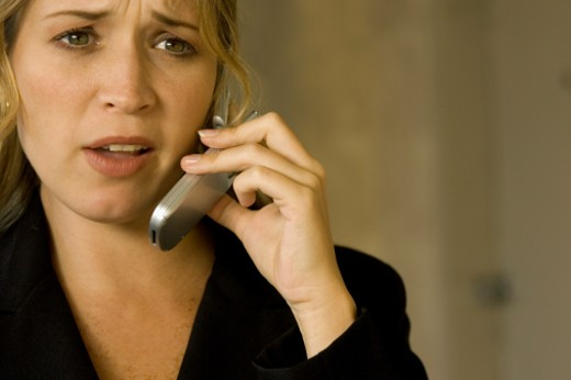 Young woman talking on a mobile phone : Stock Photo