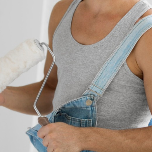 Midsection image of man holding paint roller : Stock Photo