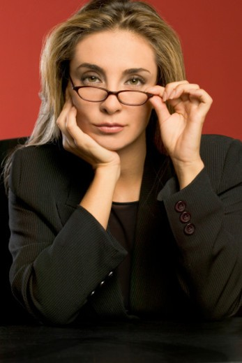 Stock Photo: 1598R-287267 Businesswoman in black suit, close-up