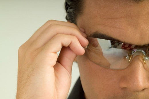 Stock Photo: 1598R-287761 Man with hand on sunglasses he is wearing, close-up, part of