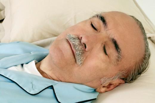 Senior man sleeping, close-up : Stock Photo