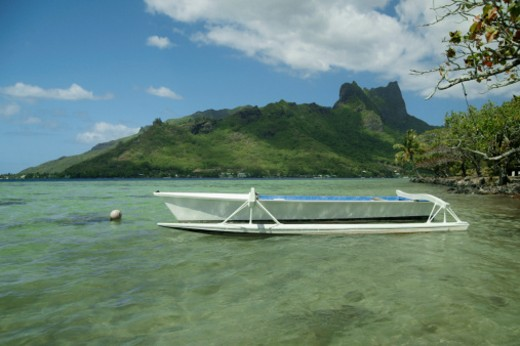 French Polynesia, Moorea, Fishing boat floating on water : Stock Photo