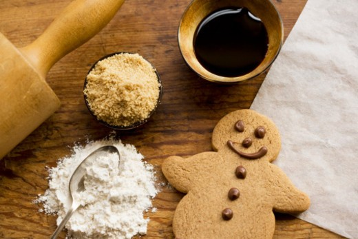 Stock Photo: 1598R-288894 Gingerbread man with ingredients and rolling pin