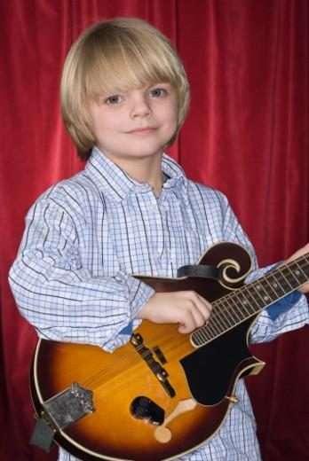 Portrait of boy (4-5) with mandolin : Stock Photo