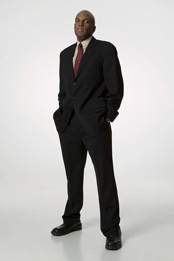 Stock Photo: 1598R-3034 Man wearing suit, standing with hands in pockets, portrait