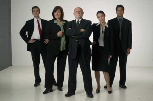 Five business people standing side by side, posing in studio, portrait : Stock Photo