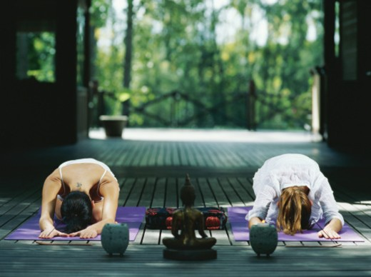 Two women performing yoga on terrace : Stock Photo