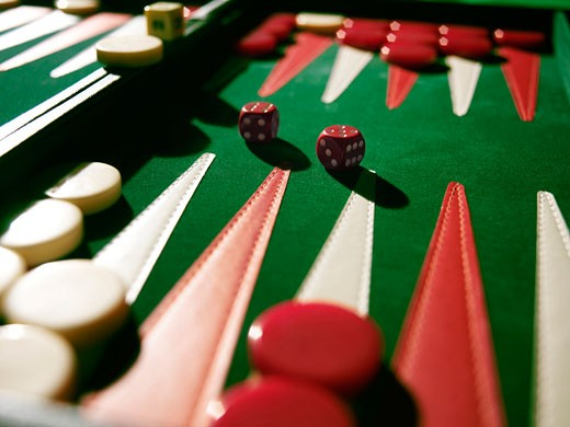 Stock Photo: 1598R-36251 Dice on backgammon board (focus on dice)