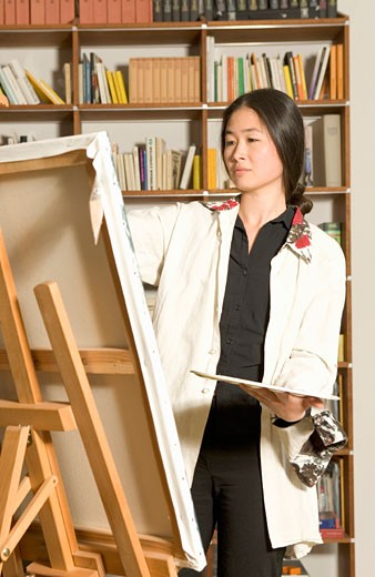 Stock Photo: 1598R-38572 Young woman painting, holding palette