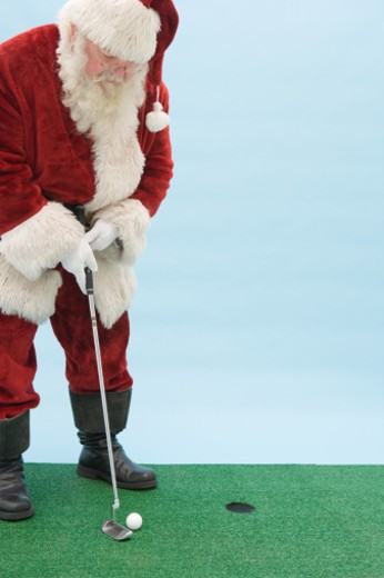 Santa Claus playing golf : Stock Photo