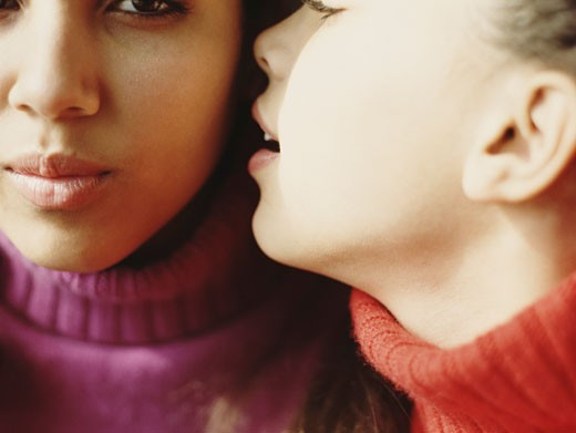 Stock Photo: 1598R-41181 Girl (8-10) whispering in teenage sister's (13-15) ear, close-up