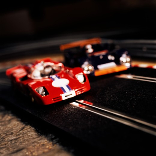 Electric slot cars, close-up (focus on red car) : Stock Photo