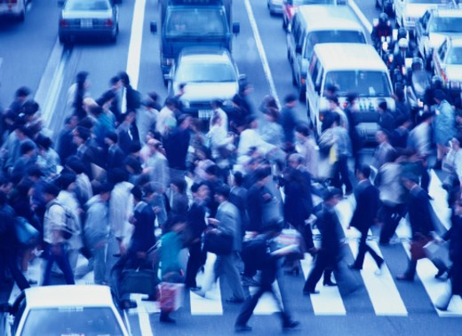 Crowd crossing street, elevated view (blurred motion) : Stock Photo