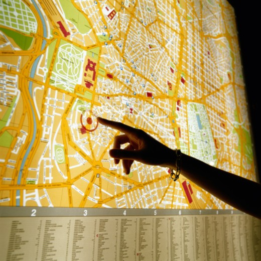 Hand Pointing at Map of Madrid : Stock Photo