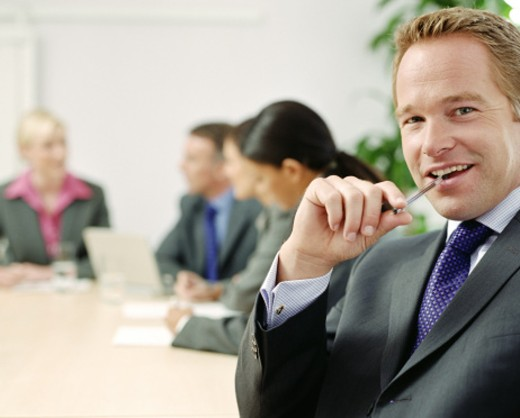 Stock Photo: 1598R-44153 Businessman in conference room