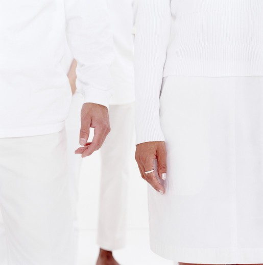Group of men and women in white, mid section : Stock Photo