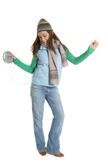 Stock Photo: 1598R-4579 Teenage girl (15-17) wearing headphones, dancing and smiling