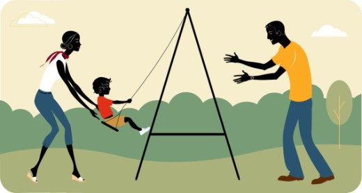 Parents pushing child on swing : Stock Photo