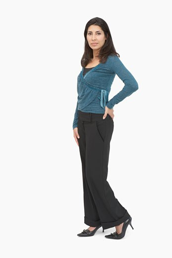 Stock Photo: 1598R-51966 Portrait of a mid adult woman standing with her hand on her hip