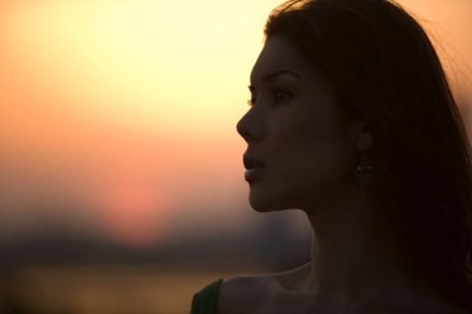 Stock Photo: 1598R-520 Young woman at sunset
