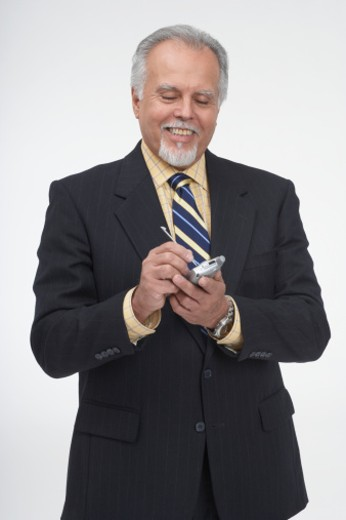 Businessman using a personal data assistant : Stock Photo