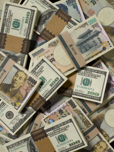 Stock Photo: 1598R-52331 Piles of Yen and US Dollar  banknotes stacked on each other, full frame
