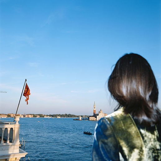 Woman watching Doges Palace, Venice Italy : Stock Photo