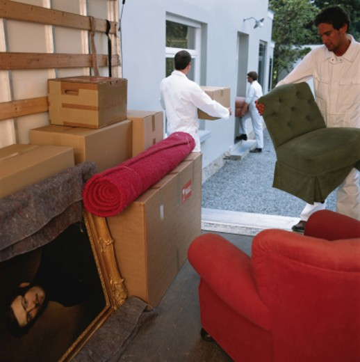 Stock Photo: 1598R-55397 Delivery men unloading household thing from van