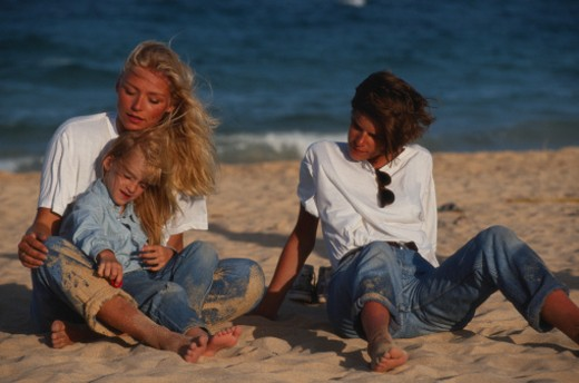 Family at beach, close up : Stock Photo