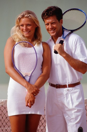Stock Photo: 1598R-56007 Man and woman holding tennis rackets