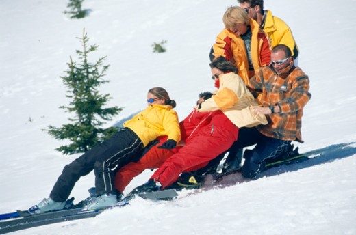 Group of people falling down skiing : Stock Photo