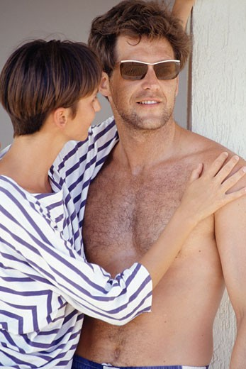 Stock Photo: 1598R-56318 Woman embracing man