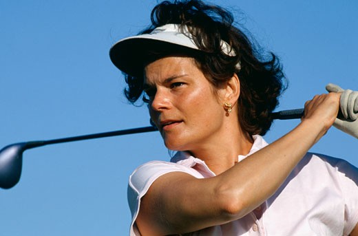Stock Photo: 1598R-57902 Woman playing golf, close-up