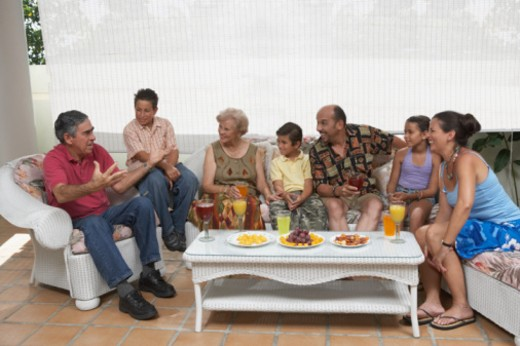 Family sitting on couches : Stock Photo