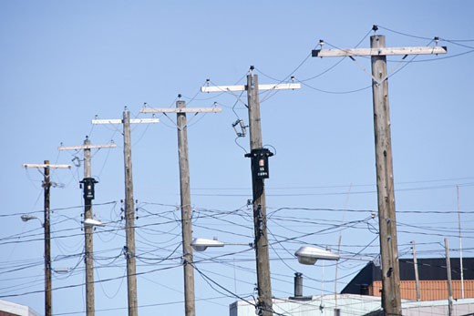 Telegraph poles in line, Pond Inlet, Baffin Island, Canada : Stock Photo