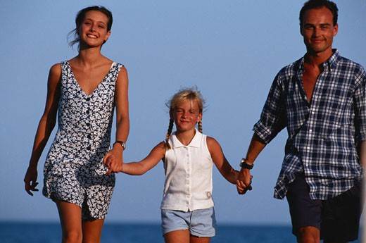Stock Photo: 1598R-60587 Parents walking with daughter, holding hands