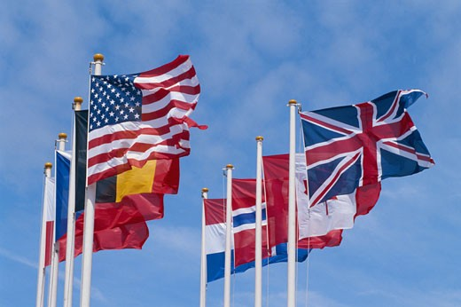 Stock Photo: 1598R-61684 International flags, low angle view
