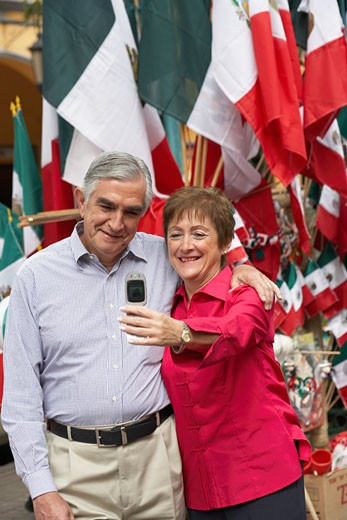 Mature couple taking their picture with a mobile phone : Stock Photo