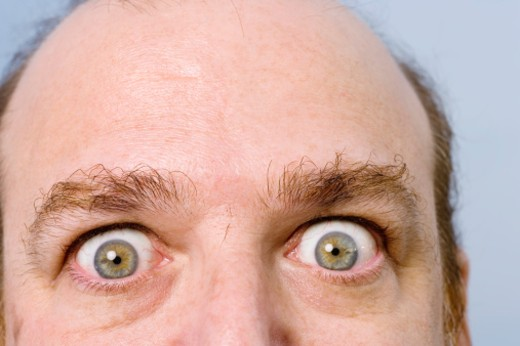 Mature man with eyes opened wide, portrait, close-up : Stock Photo