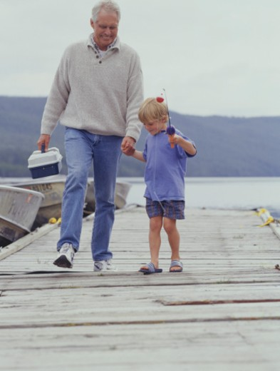 Stock Photo: 1598R-63857 Grandfather and grandson (6-7) walking on pier