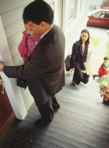 Stock Photo: 1598R-63915 Family standing on steps at home, elevated view
